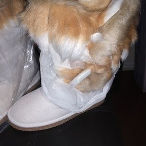 Faux fur white boots just fab